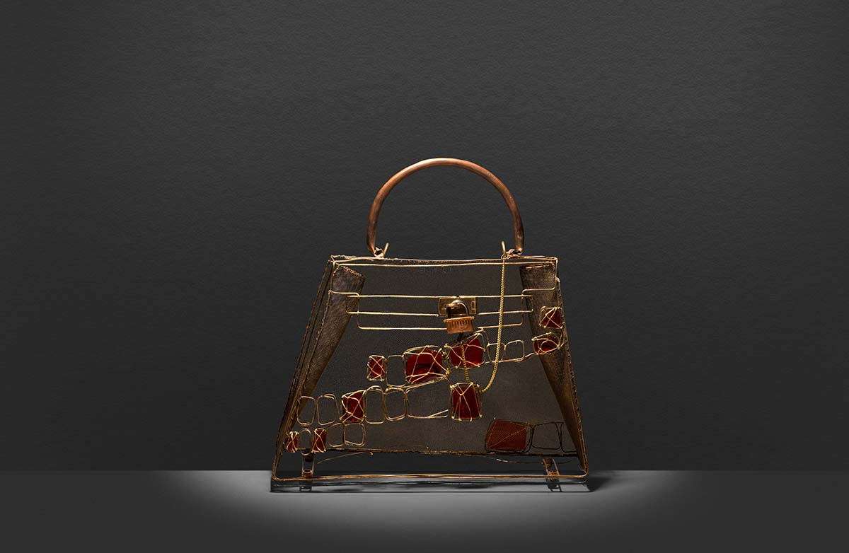 Life size wire and glass replica of the Crocodile finish of The Kelly an iconic Hermès handbag.