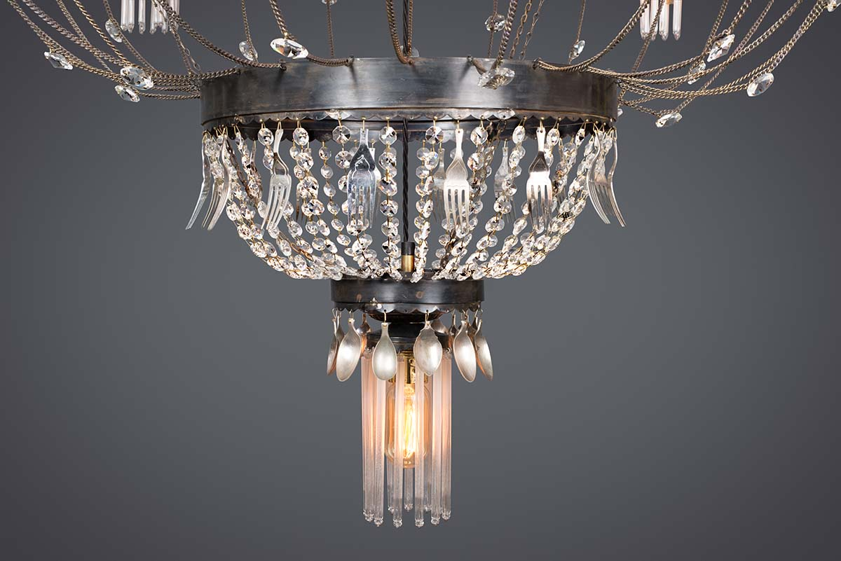Ambrosia large round chandelier. close up. Custom made from Recycled materials and vintage cutlery.