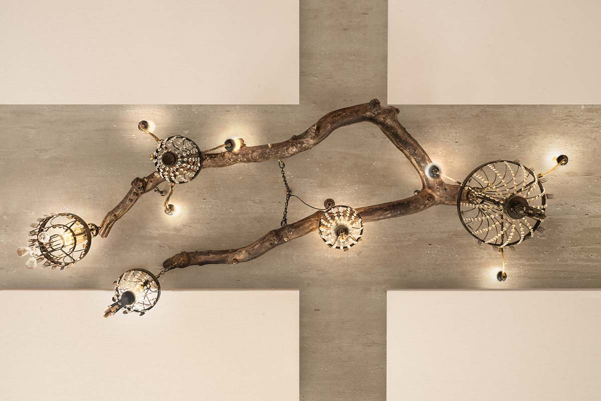 Ambrosia Branch installation with chandeliers hanging from it.