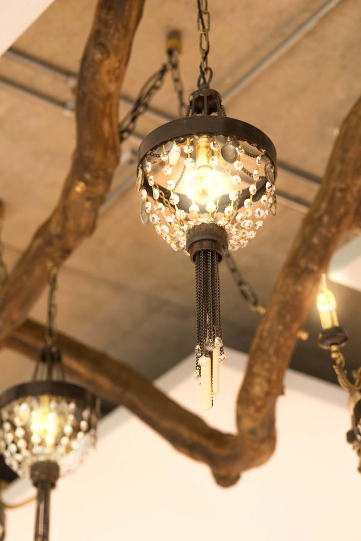 Chandelier made from repurposed materials. Cutlery, crystals and chain.